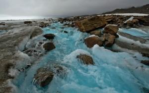 blue glacier stream in the alaska range