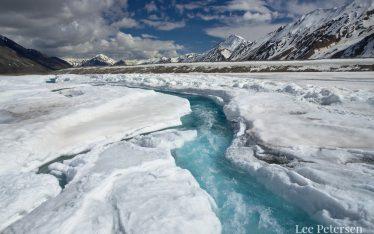Blue stream on the Black Rapids Glacier in the Eastern Alaska Range