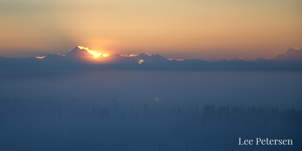 Watching the sunrise over Mt. Hayes in the Alaska Range from the lobby stairwell window in the Museum of the North