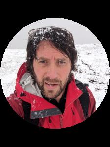 Selfie portrait of Lee Petersen on a snowy August day in Denali National Park